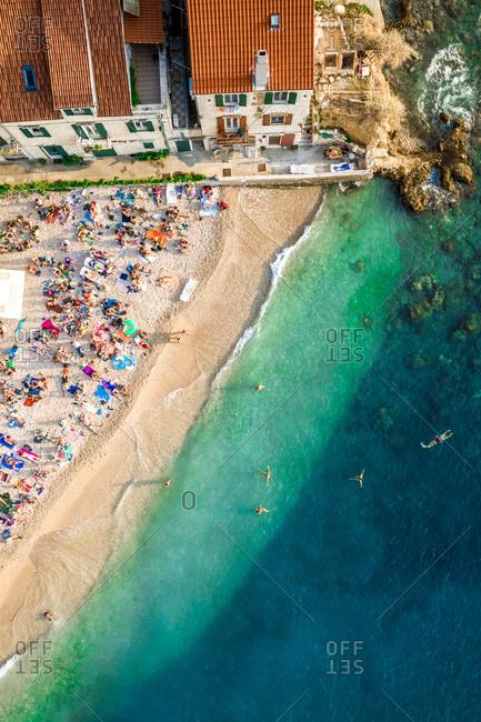 September 12, 2019 - Komiza, Croatia: Aerial view of tourists at Kod Senke Hotel on Komiza beach