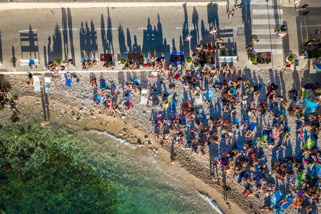 September 14, 2019 - Komiza, Croatia: Aerial view of tourists at Kod Senke hotel on Komiza beach