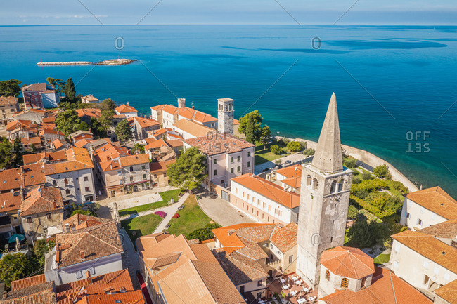 October 11, 2019: Aerial view of the Euphrasic Basilica surrounded by turquoise water in Porec, Croatia