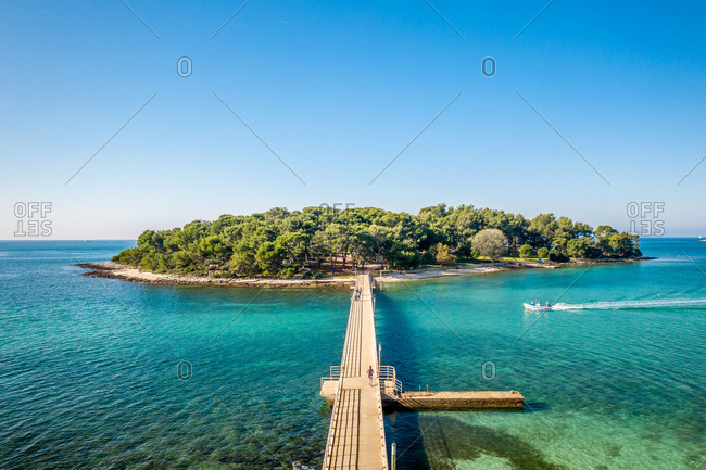 Aerial view of Koversada island surrounded by turquoise water in sunny day, Croatia