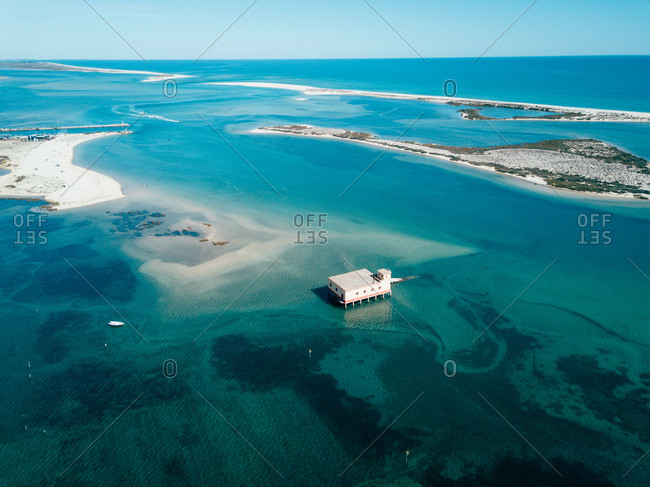Aerial view of an old lifeguard station on the lagoon towards Ilha da Fuseta in the Ria Formosa district of the Algarve, Portugal