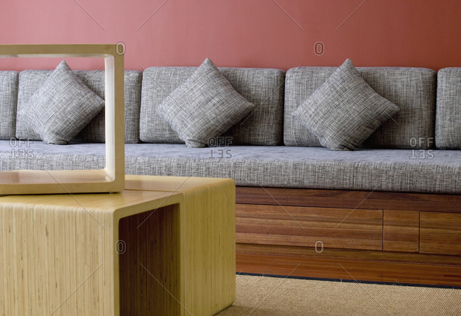 Seating bench with cushions and coffee table.