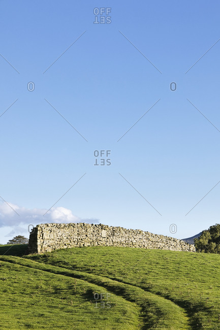 Dry stone wall in rural landscape.