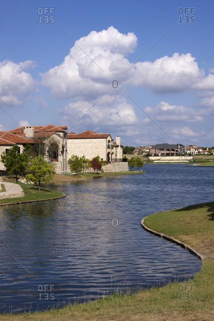 River running through residential neighborhood.
