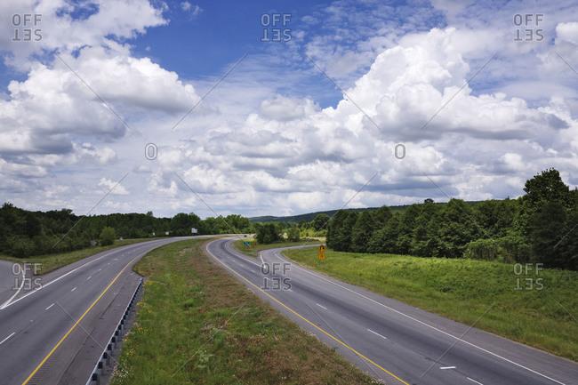 Rural highway under blue sky