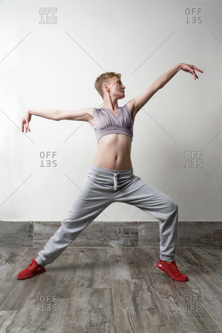 Woman in dance pose, arms outstretched