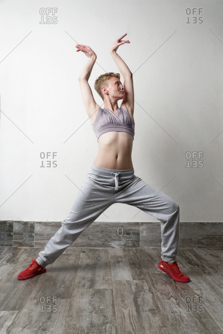 Woman in dance pose, arms raised