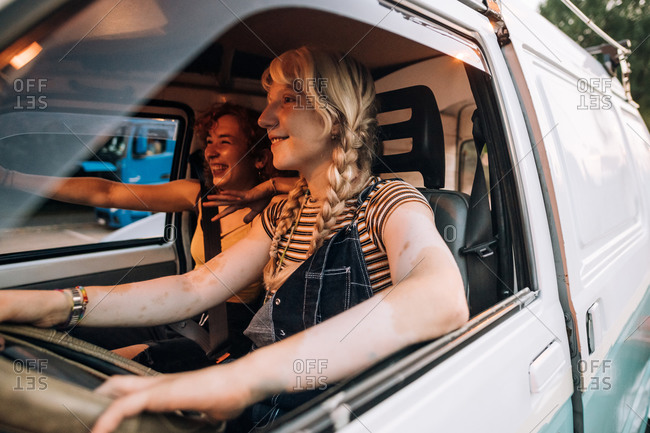 Happy female couple in van