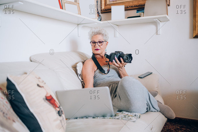 Photographer working on laptop at home