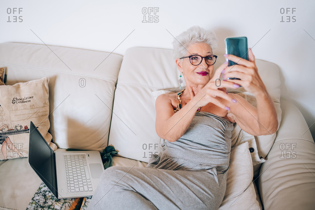 Woman having video call on her phone at home