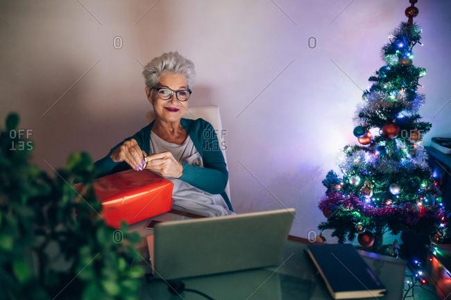 Woman on video call with Christmas gift