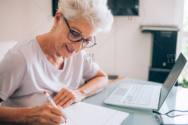Senior woman working at home