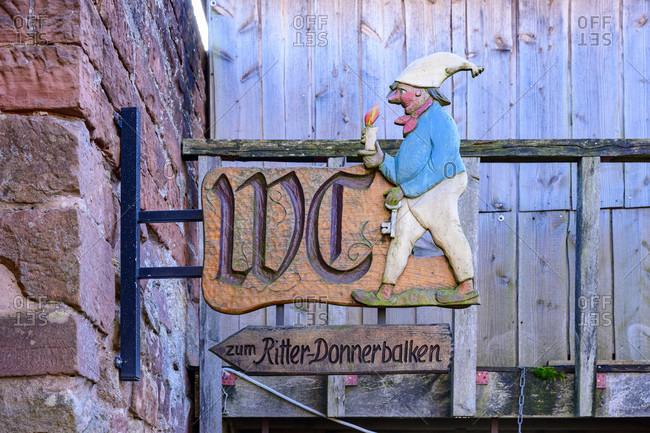 November 30, 2019: Germany, Rhineland-Palatinate, Southern Palatinate, Klingenmunster, toilet sign on Landeck Castle.