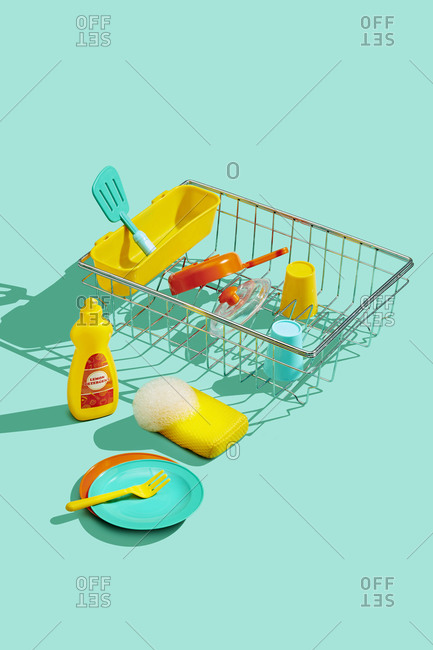 Toy Dishes Drying in Dish Rack on Blue