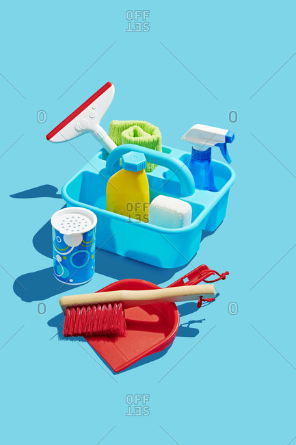 Toy Cleaning Supplies in Caddy on Blue