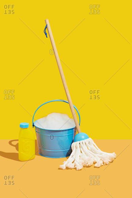 Toy Mop and Bucket with Soap on Yellow