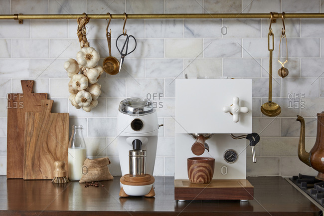 Modern kitchen with fancy coffee appliances and brass finishes