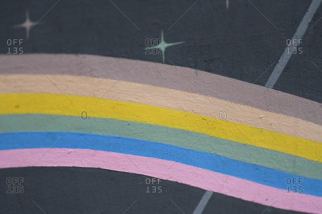 Pastel rainbow painted on concrete