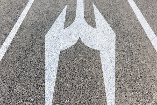 Directional arrows and lines painted on concrete