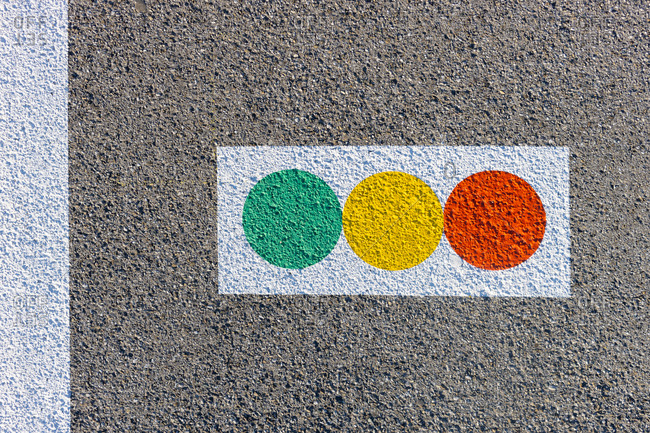 Colorful traffic symbol painted on concrete