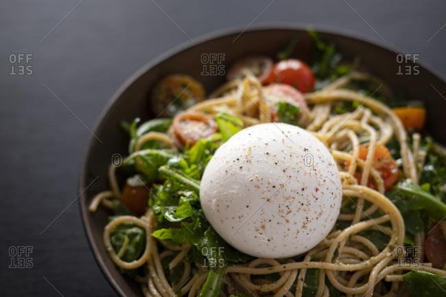 Spaghetti with arugula, pesto and burrata