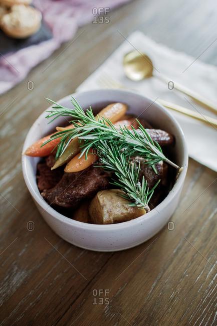 Pot roast dish with roasted baby rainbow carrots and rosemary