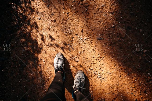 Woman trekking shoes walking on dirt roads in autumn