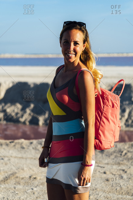 Smiling woman near pink lake in Las Coloradas, Yucatan