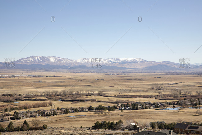 Bird's eye view over homes near snowy mountain in Genoa, Nevada