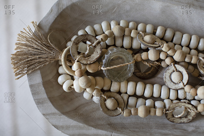 Decorative dish with beads and bohemian accents