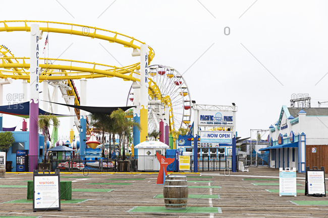 Santa Monica, California - July 22, 2020: Closed gates and empty rides at the Santa Monica Pier during the Covid-19 pandemic