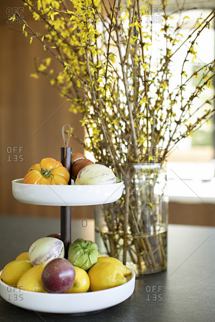 Fresh produce on a two-tier stand on kitchen counter