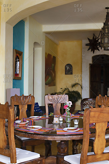 Sayulita, Nayarit, Mexico - June 13, 2018: Dining room interior in a home with colorful placemats