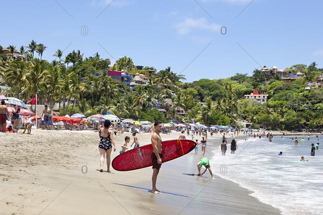 Sayulita, Nayarit, Mexico - June 15, 2018: Crowded beach on the Pacific coast of Sayulita