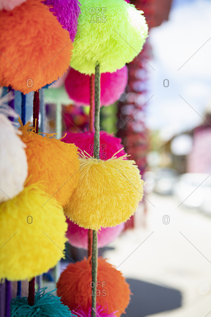 Colorful pom-pom garlands for sale at a shop in Sayulita, Nayarit, Mexico