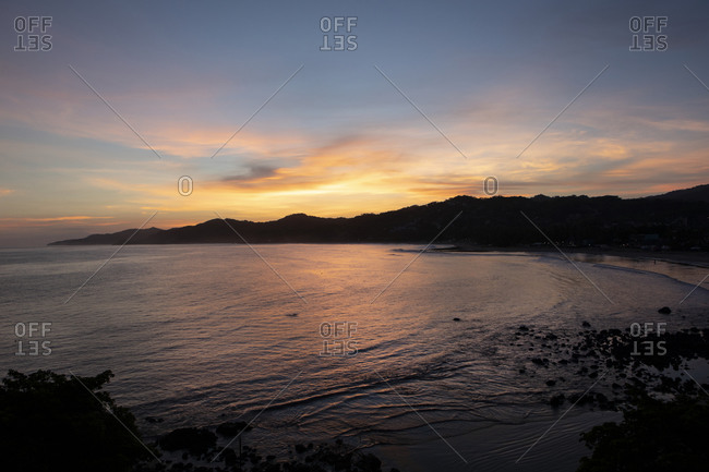 Colorful sunset over the Pacific Ocean and coast of Sayulita, Nayarit, Mexico