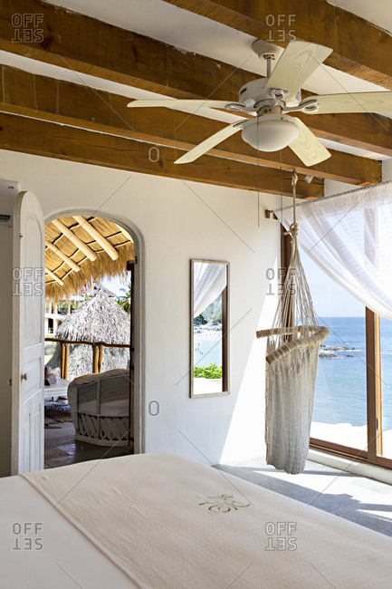 Sayulita, Nayarit, Mexico - June 17, 2018: Hotel with ocean view and hanging chair in corner of bedroom