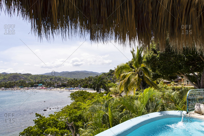 Sayulita, Nayarit, Mexico - June 17, 2018: Oceanfront resort with swimming pool on the coast of the Pacific Ocean