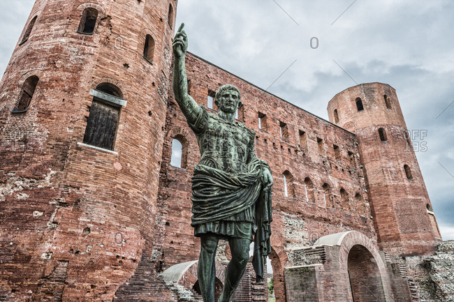 Italy, Piemonte (Piedmont), Torino (Turin) . View of Porta Palatina (Palatine Gate), on the foreground the bronze replica statue of the Roman Emperor Augustus Caesar