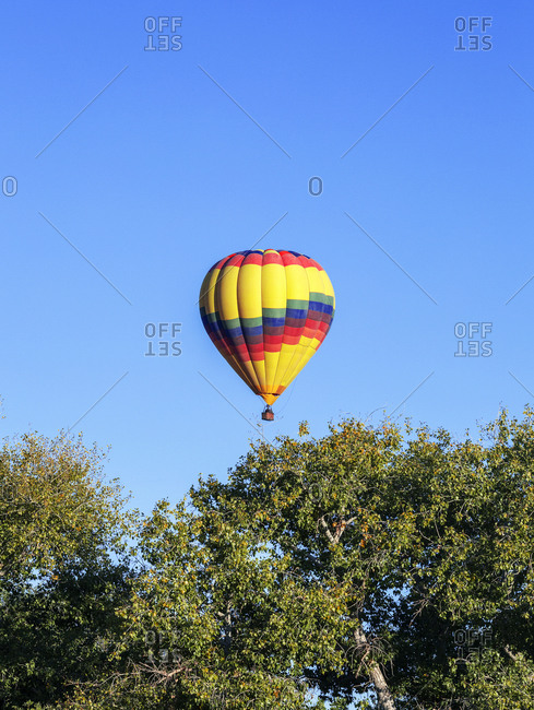 Colorful Hot Air Balloon Floats  in the sky, in New Mexico