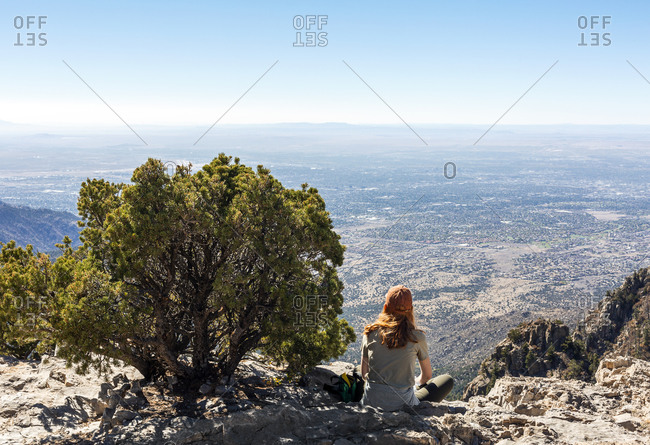 Redhead Woman Sitting at the Sandia Mountaintop in Albuquerque New Mexico