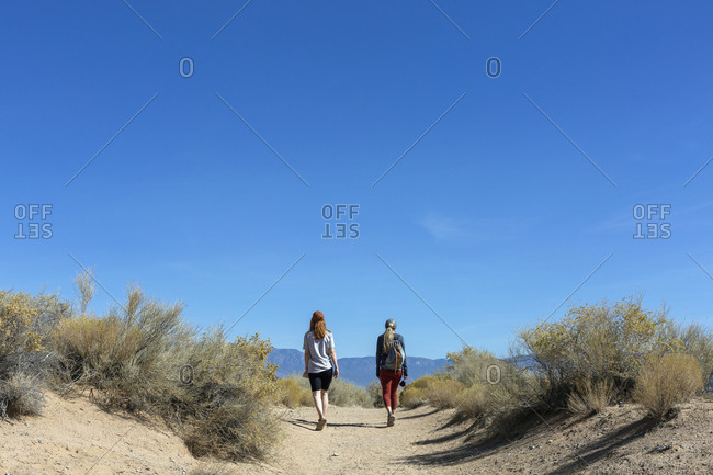 Two Women Hiking a Volcanic Field Outside of Albuquerque New Mexico