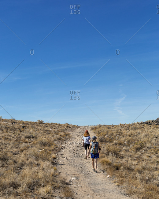 Mother and Daughter Hiking in a Volcanic Field Outside of Albuquerque New Mexico