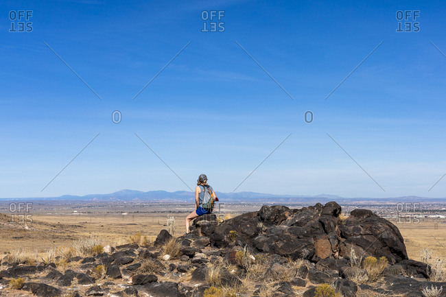 Woman Sitting on a Rock at a Volcanic Field Outside of Albuquerque New Mexico