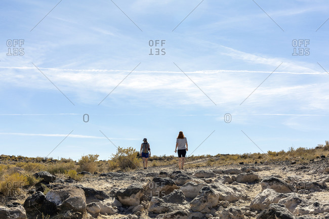 Two Women Hiking in a Volcanic Field Outside of Albuquerque New Mexico