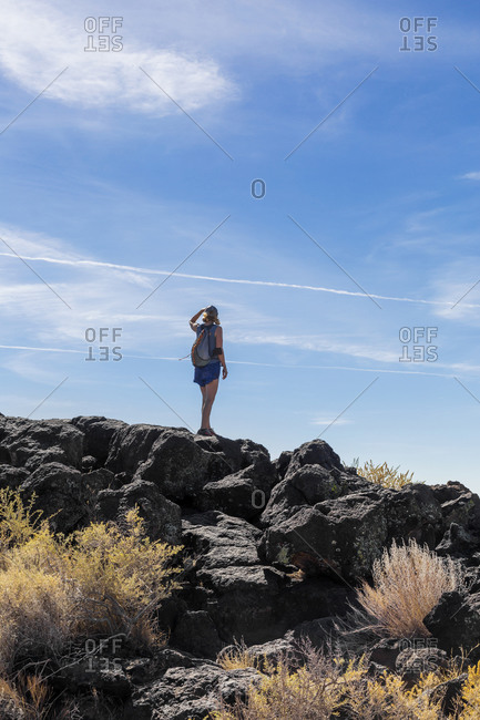 Woman Standing on a Rock in a Volcanic Field Outside of Albuquerque New Mexico