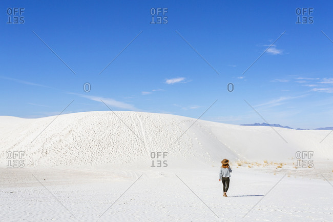 Redhead Woman Hiking on Sand Dunes at White Sands Park in New Mexico