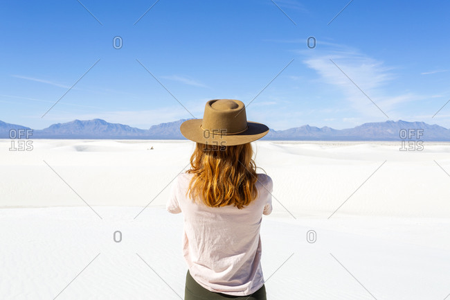 Redhead Woman Taking a Photo at White Sands National Park in New Mexico
