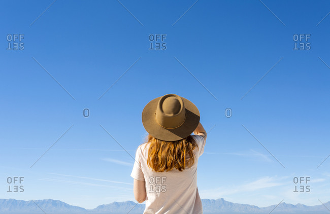 Redhead Woman Wearing a Wide Brim Hat at White Sands National Park