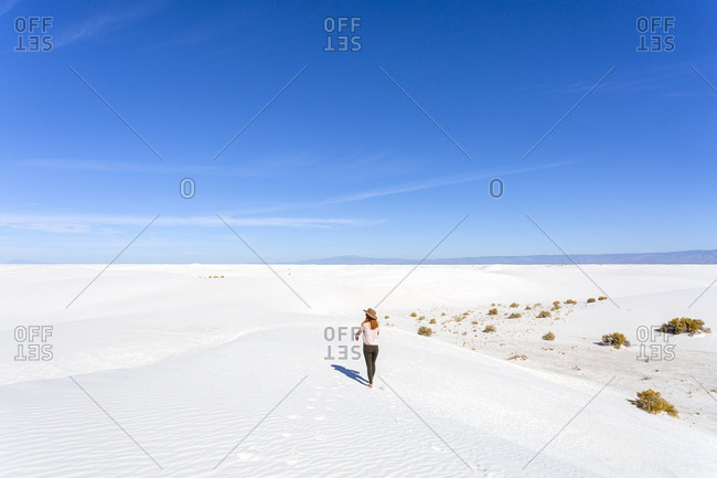 Redhead Woman Wearing a Hat Walking at White Sands Park